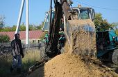 Tractor Digging A Hole With Shovel