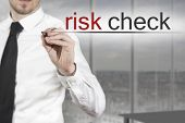 Businessman Writing Risk Check In The Air