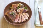 picture of duck breast  - Roasted duck breast with figs and rosemary in wine sauce - JPG