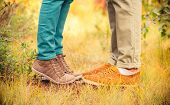 image of legs feet  - Couple Man and Woman Feet in Love Romantic Outdoor with Autumn season nature on background Fashion trendy style - JPG