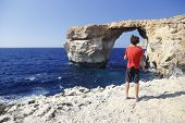 Boy In Front Of Famous Stone Arch Of Gozo Island