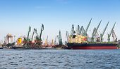 Industrial Cargo Ship Is Loading In Port Of Varna, Bulgaria