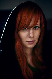 pic of gothic hair  - Dramatic portrait of beautiful red hair woman in black hood - JPG