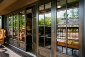 Glazed Entrance To The Luxurious Restaurant - Door Opens