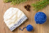 stock photo of knitted cap  - ball of threads knitting cap pine - JPG