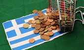 Shopping Cart Full Of Coins Euro Toppled Over Flag Of Greece