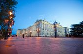 Royal Palace With Tourists On A Spring Night In Madrid