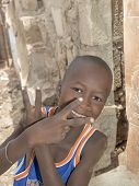 Editorial caption: THIAROYE, SENEGAL, AFRICA - AUGUST 2, 2014 - Boy standing in the street
