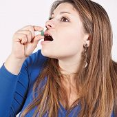 picture of disgusting  - girl approaches the mouth a disgusting medicine - JPG