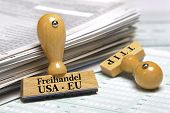 pic of free-trade  - TTIP free trade agreement betwenn USA and Europe marked on rubber stamp over documents - JPG