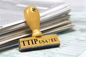 image of free-trade  - TTIP free trade agreement betwenn USA and Europe marked on rubber stamp over documents - JPG