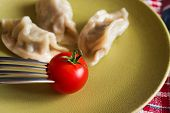 image of no clothes  - Chinese jiaozi with tomato on green and red plates - JPG