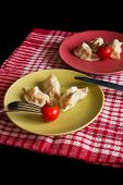 pic of no clothes  - Chinese jiaozi with tomato on green and red plates - JPG