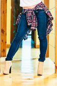 Girl Legs In Denim Trousers High Heels Boots