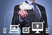 Person presses hologram of cloud computing