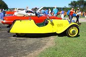 A three wheeled antique car