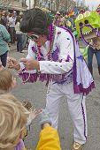 Elvis Character Bestows Mardi Gras Beads