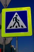 stock photo of pedestrian crossing  - image of pedestrian crossing sign on street - JPG