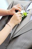 foto of debonair  - Wedding boutonniere placed on jacket of groom - JPG