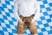 Bavarian man with brown Oktoberfest leather pants (Lederhose).