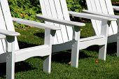 Arrangement of white adirondack chairs