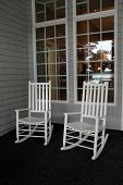 Two Adirondack chairs on front porch