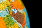 picture of flag pole  - map with miniature flag of Israel  - JPG