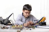 picture of experiments  - Young student performs experiments in electronics and dreams of the future - JPG