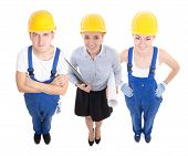 Team Work Concept - Handsome Man And Beautiful Woman In Blue Builder's Uniform With Female Architect