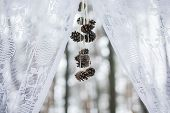 stock photo of wedding arch  - Wedding arch with pine cones at winter wedding - JPG
