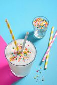 picture of sprinkling  - Glass of milk and Sprinkles with paper straws - JPG