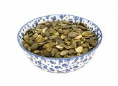 Pumpkin Seeds In A Blue And White China Bowl