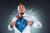 foto of heroes  - businessman acting like a super hero and tearing his shirt off on a gray background - JPG