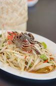 stock photo of green papaya salad  - spicy papaya salad with crab on dish asian spicy food - JPG