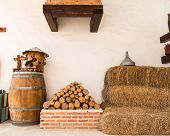 picture of farmhouse  - close up pile of firewood material on a farmhouse background - JPG