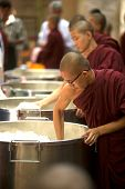 Buddhist Monks Is Working A Rice To Be Distributed