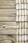 Wine corks on the wood in the vertical format