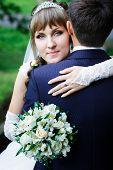 Bride hugging groom.