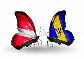 Two Butterflies With Flags On Wings As Symbol Of Relations Latvia And Barbados