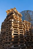 Stacked Up Colorful Wooden Cargo Pallets