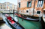 Gondolas Next To Ponte Dell Academia In Venice