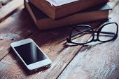Books, Smartphone And Glasses