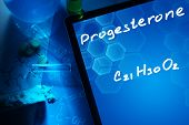 foto of formulas  - Tablet with the chemical formula of progesterone - JPG
