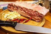 Fresh Pork Ribs, Meat Marinated And Prepared For Roast With Garlic. Laying On A Wooden Table On A Ro