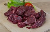 image of deer meat  - Raw wild venison meat - ready for cooking ** Note: Shallow depth of field - JPG