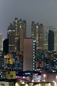 City night with modern skyscrapers under sky in Hong Kong, Asia.