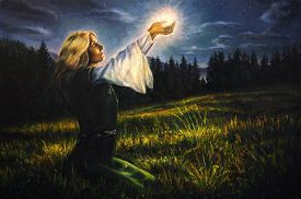 foto of wicca  - beautiful painting oil on canvas of a mystical young woman in green emerald medieval dress is holding a glowing ball of light in her palms amids a nocturnal meadow - JPG