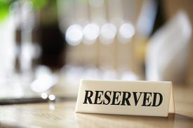 picture of salt shaker  - Restaurant reserved table sign with places setting and wine glasses - JPG