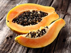 picture of papaya fruit  - Ripe papaya in a wooden background - JPG