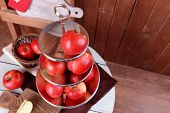 stock photo of serving tray  - Tasty ripe apples on serving tray on table on wooden background - JPG